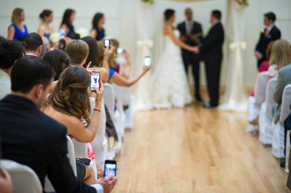 Image result for guests taking pictures at wedding